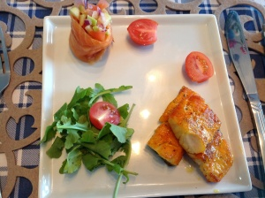 Rolled salmon stuffed with Ushatini, served with haddock and rocket