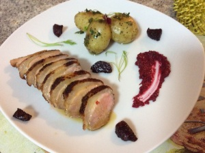 Crispy skin duck served with coriander potatoes, beetroot puree and sweet citrus sauce