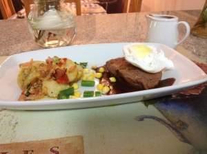Ostrich fillet with potato, poached egg and red wine jus