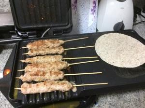 Grilling the pork kebabs