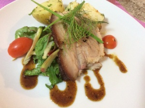 Roasted pork belly with potato rosti and greens