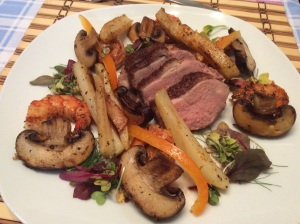 Surf and Turf salad with crispy skinned duck and prawns