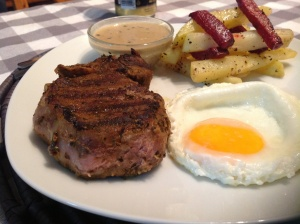 Rib-eye steak, fried egg, potato/beetroot chips and peppercorn sauce.