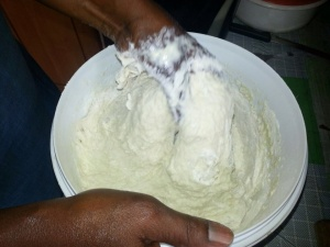 Mixing unique ingredients( flour, yeast, eggs, oil)